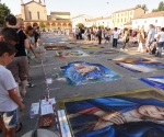 The crowds flowed through the piazza day and night