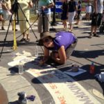 Andi Mether - taking a break from organising - chalk artist at work!