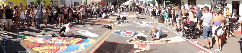 Crowds watch the artists produce their chalk masterpieces